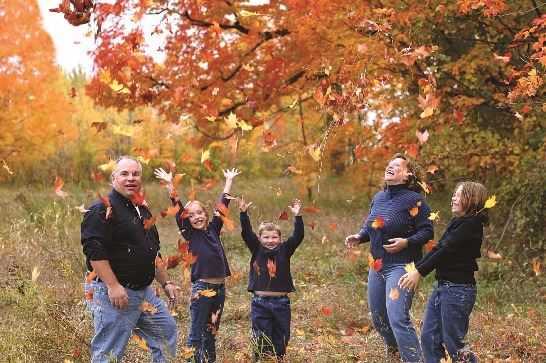 stock-photo-558564-family-in-the-leaves