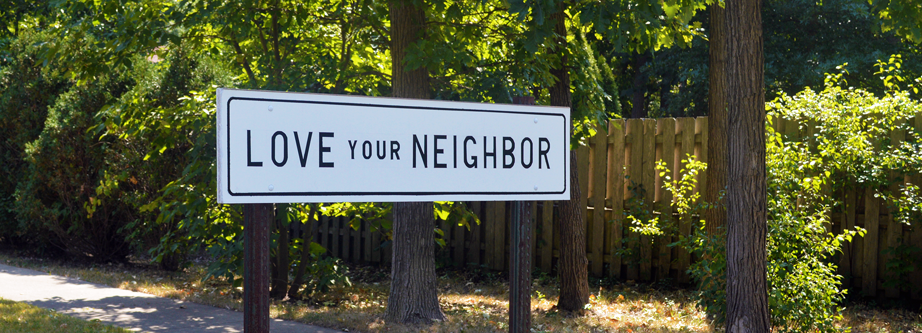 Picture of sign that says love your neighbor