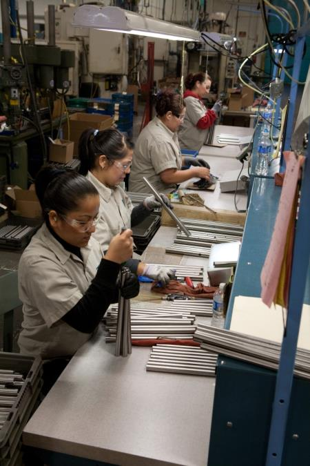 Workers Assembling Products